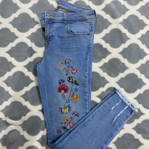 Light wash jeans with embroidered flower pattern